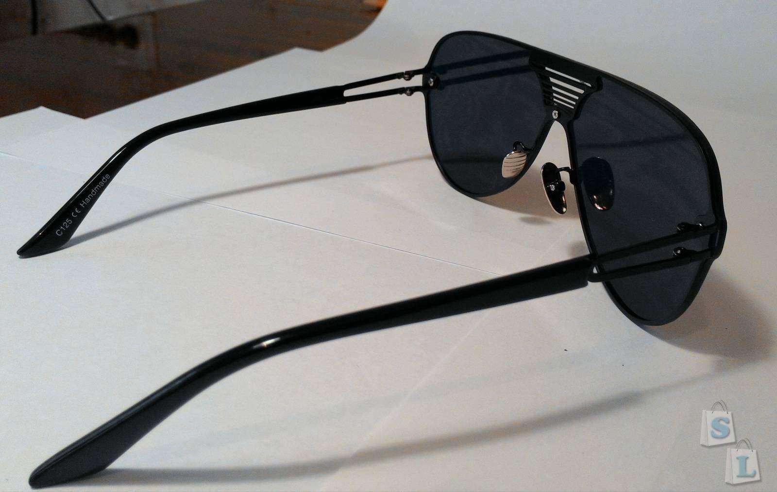Aliexpress: Стильные солнцезащитные очки с необычным дизайном.