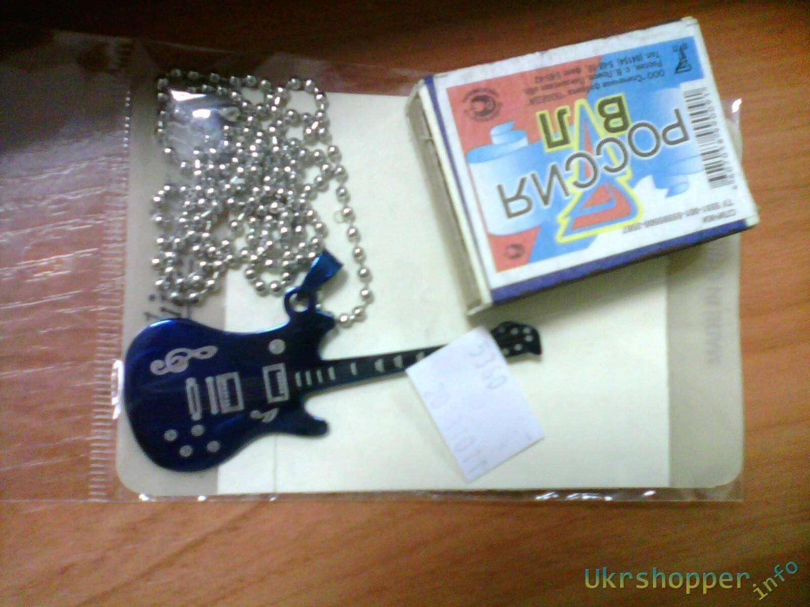 Ebay: Стилизованная подвеска в виде гитары