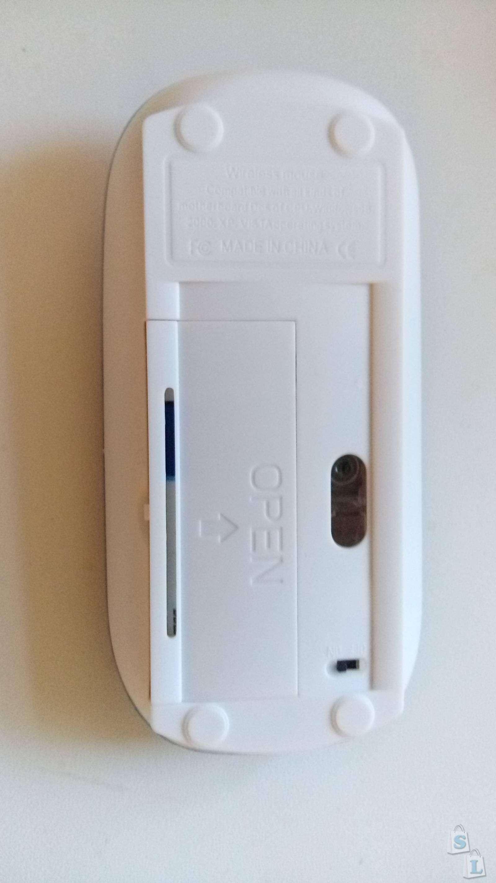 DealExtreme: Красивая, но пока бесполезная беспроводная мышка - отчет о выигрышном купоне
