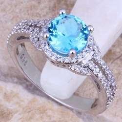 кольцо с голубым цирконом