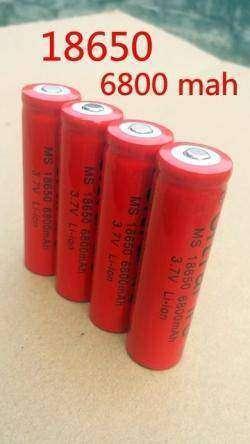 Много батареек 18650 и зарядка для их отжима
